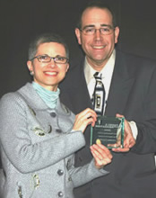 Illinois Parks & Recreation editor Rodd Whelpley presents Christine Esposito, of Terracom, with the Best Marketing Article Award. Photo: Geoff Deigan